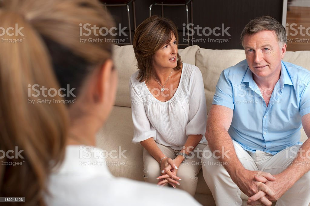 Couple arguing in a counselling session royalty-free stock photo