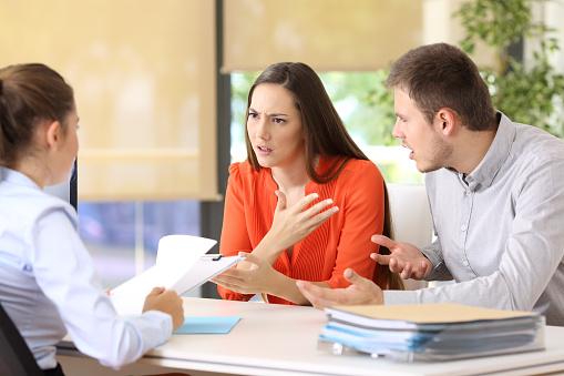 istock Couple arguing in a marriage consultory 828444016