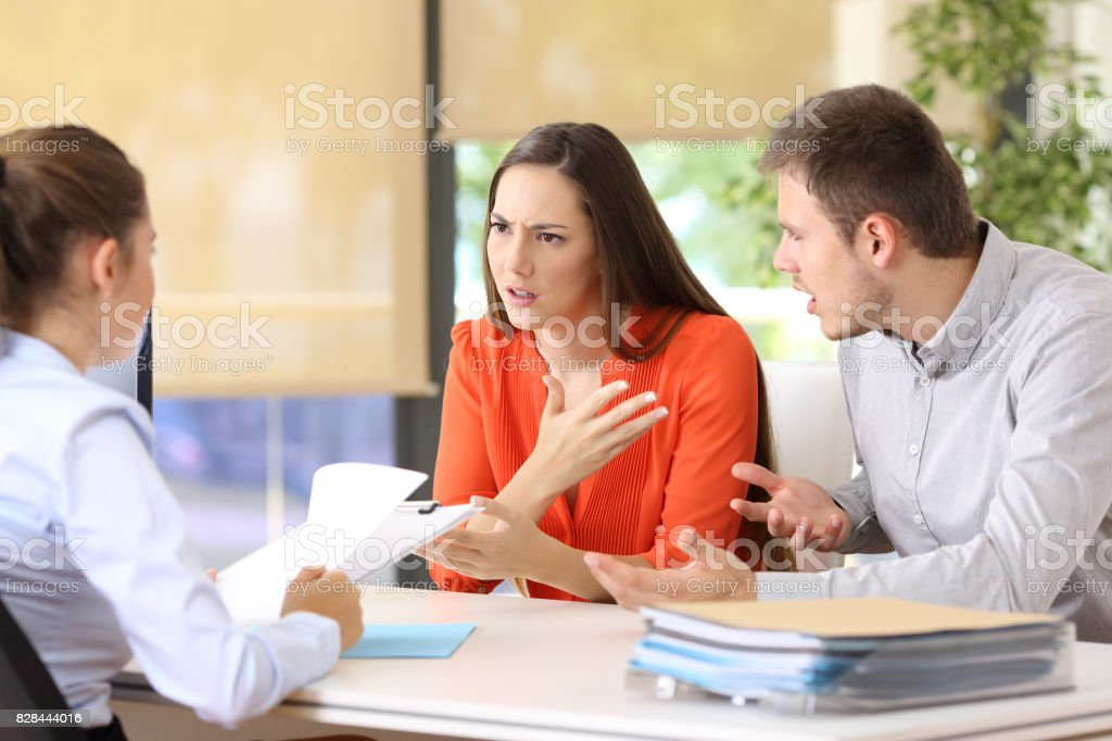 Couple arguing in a marriage consultory stock photo