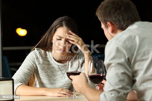 istock Couple arguing in a restaurant in the night 903237648