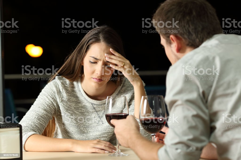 Couple arguing in a restaurant in the night stock photo