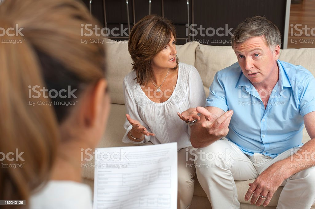 Couple arguing in counselling session with a doctor royalty-free stock photo