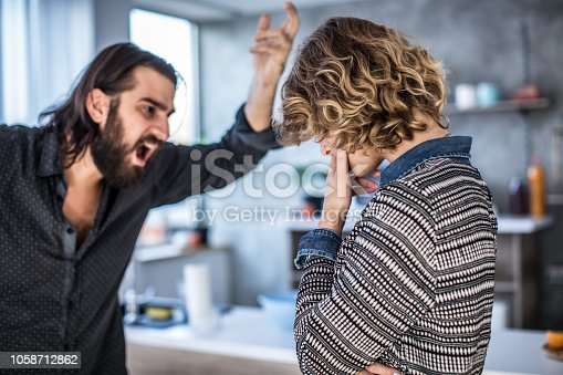 istock Couple arguing in the kitchen 1058712862