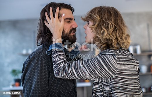 istock Couple arguing in the kitchen 1058714854