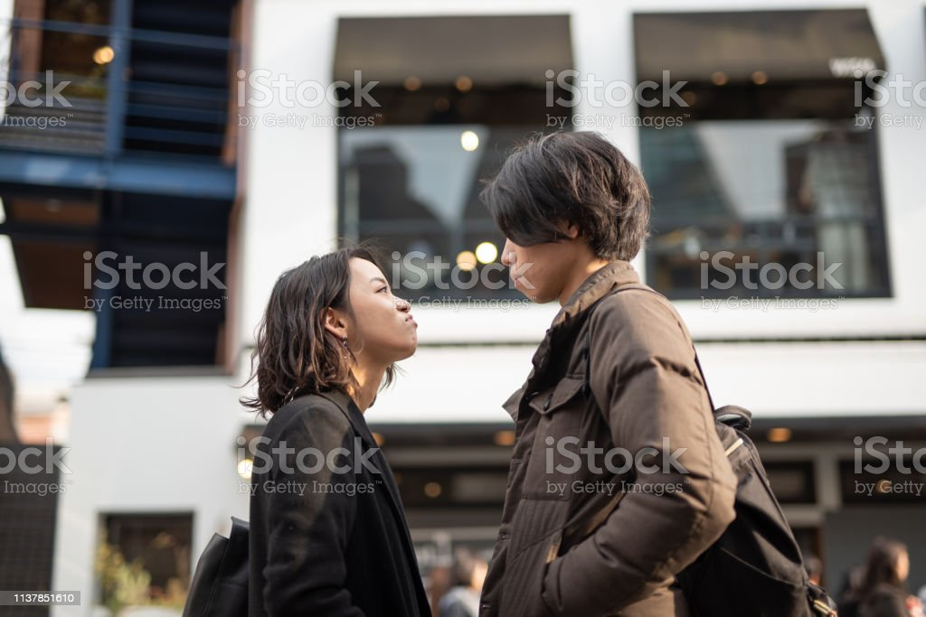 Couple arguing on street Woman and man dating 20-24 Years Stock Photo