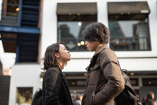 Couple Arguing On Street Stock Photo - Download Image Now