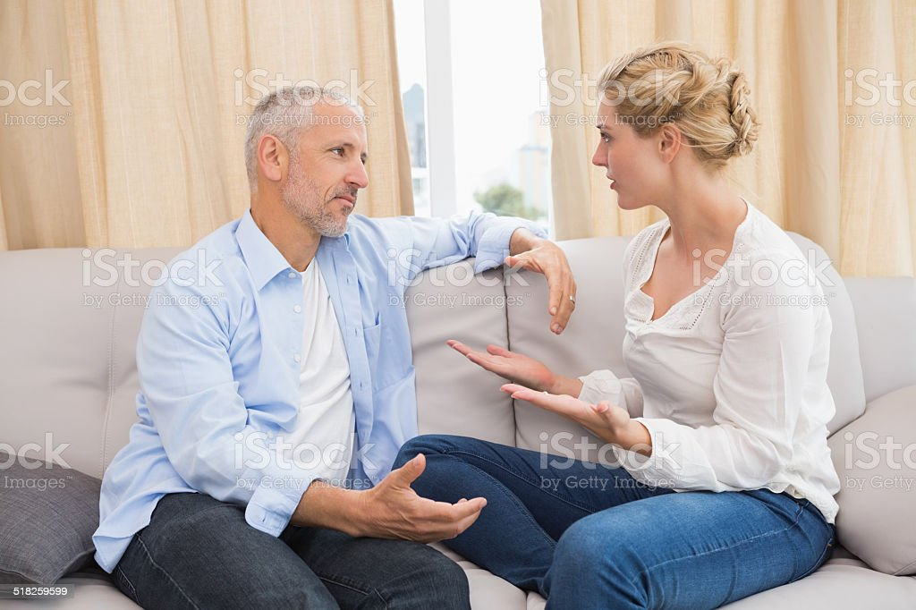 Couple arguing on the couch stock photo