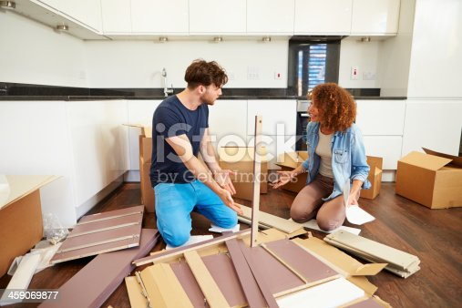 459373065 istock photo Couple arguing over self assembly furniture 459069877