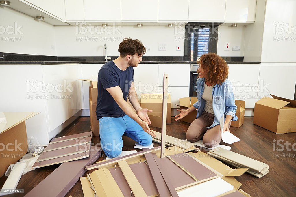 Couple arguing over self assembly furniture stock photo