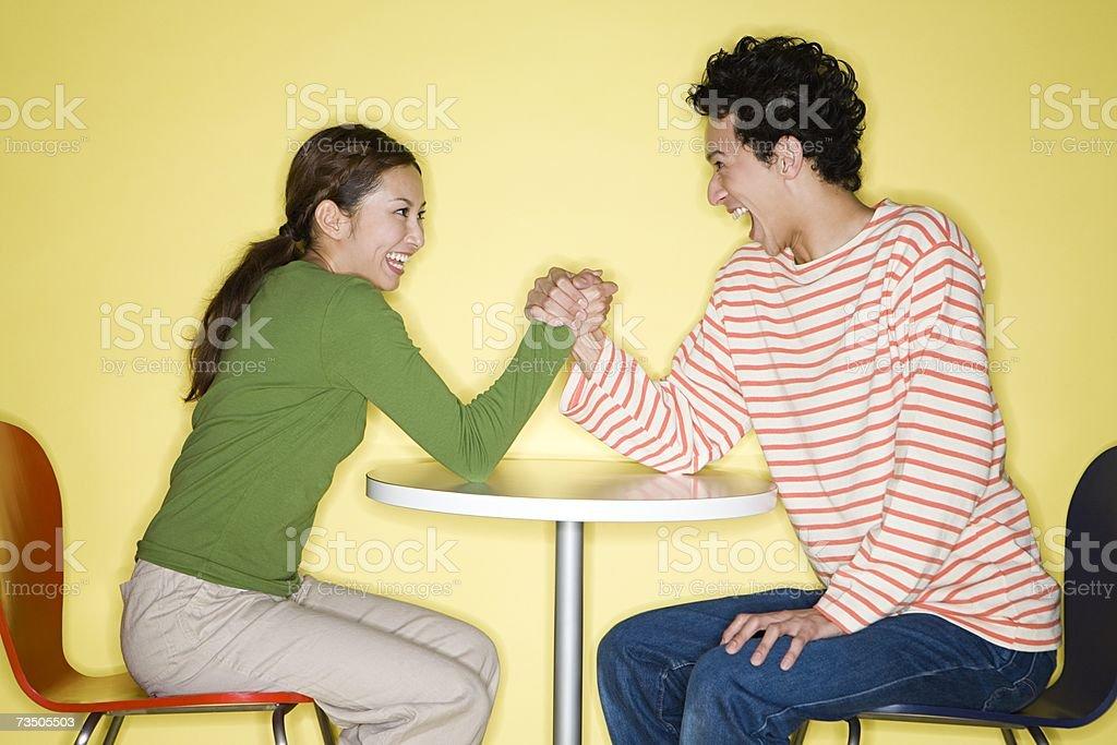 Couple arm wrestling royalty-free stock photo