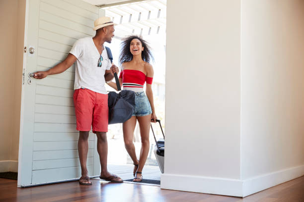 Couple Arriving At Summer Vacation Rental stock photo
