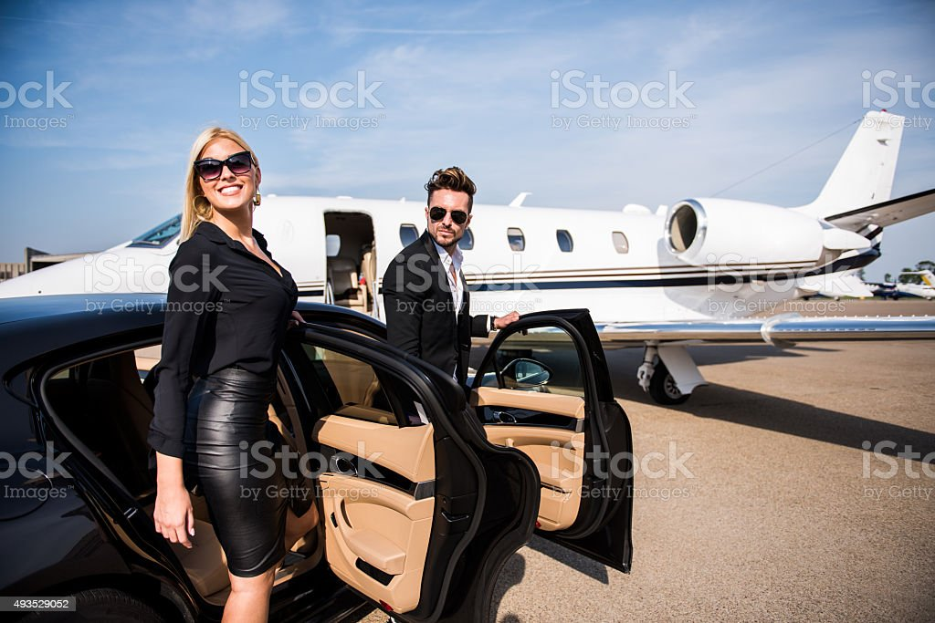 Couple arriving at the airport stock photo