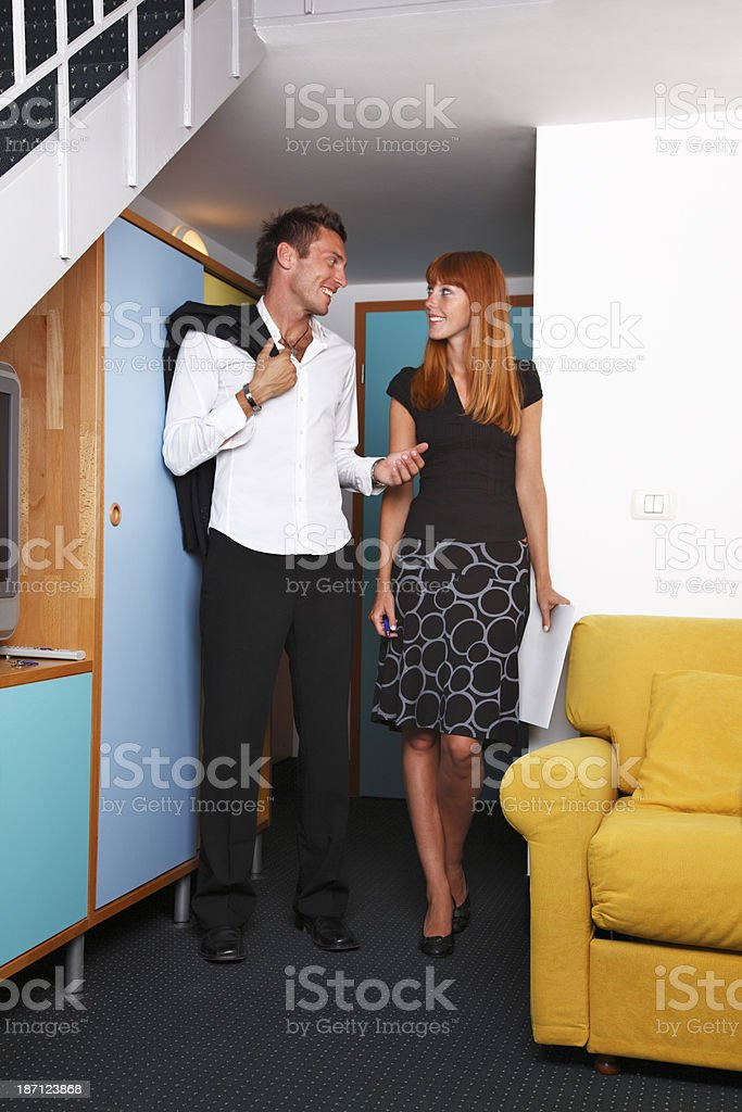 Couple arriving in hotel room royalty-free stock photo