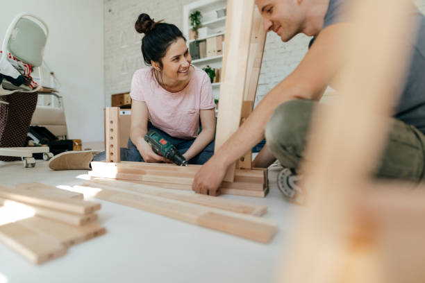 Couple assembling furniture together Couple assembling furniture together diy stock pictures, royalty-free photos & images