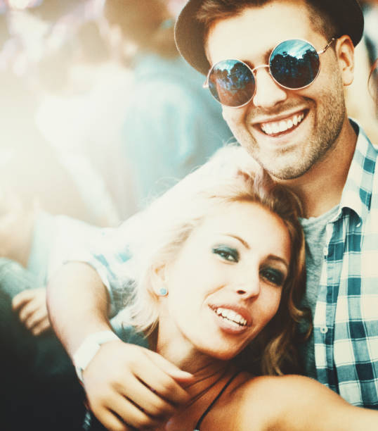 couple at a concert. - concert selfie stock photos and pictures