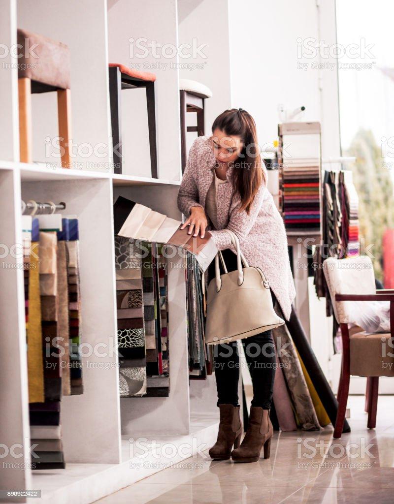 Couple at a furniture store choosing fabrics