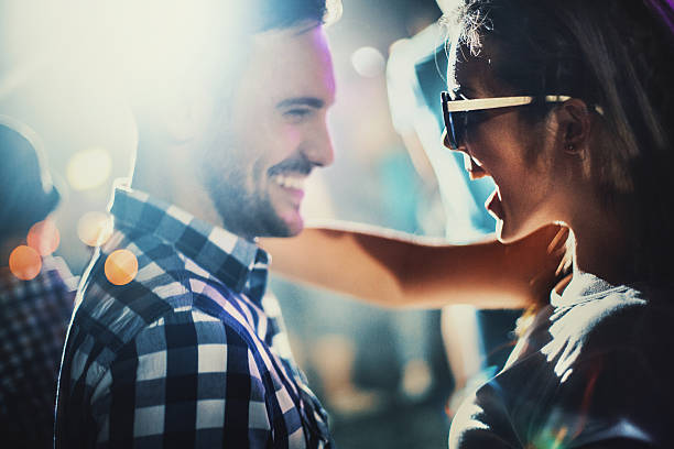 Couple at a party. - foto stock