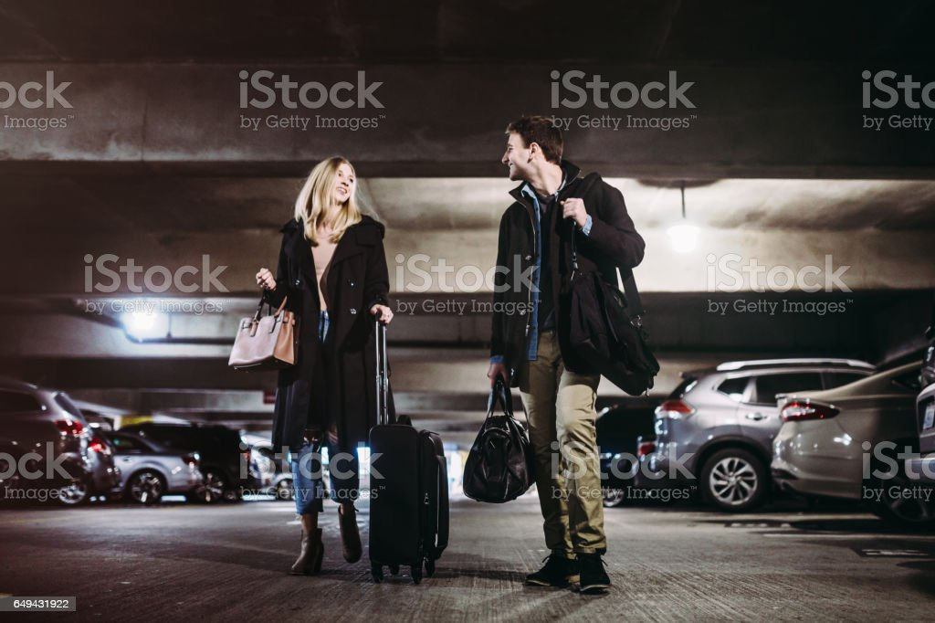 Couple at Airport Parking Garage stock photo