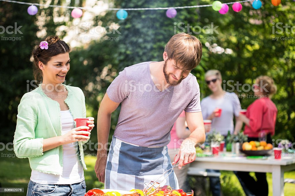 Couple at barbecue party stock photo