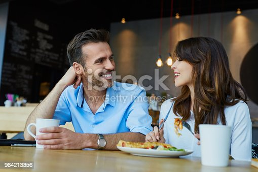 istock Couple at cafe talking during lunch 964213356