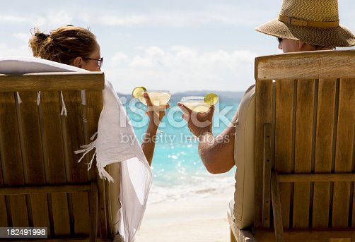 istock Couple at Caribbean beach with margarita cocktails 182491998