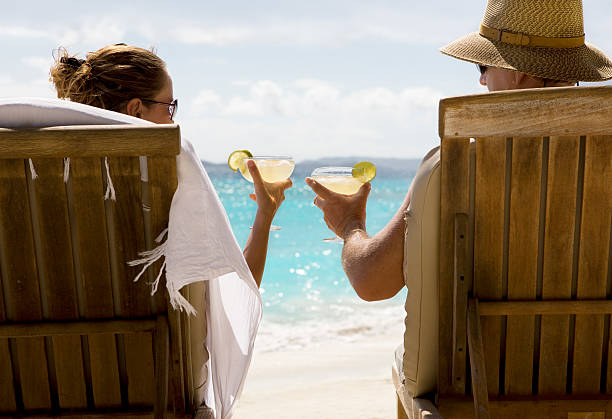couple at caribbean beach with margarita cocktails - margarita drink stock photos and pictures