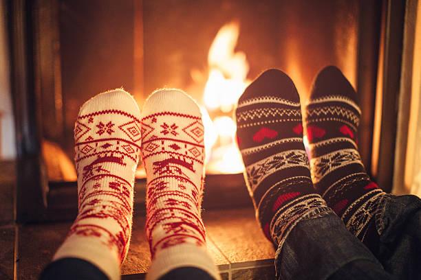 couple at cozy winter vacation. - kütük ev stok fotoğraflar ve resimler