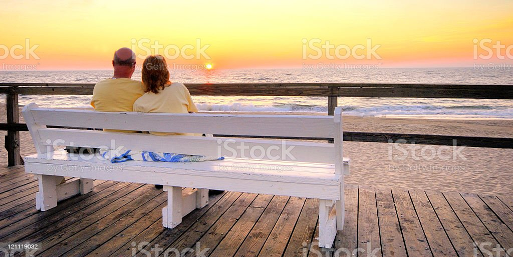 Couple at Dawn - Bethany Beach, Delaware stock photo