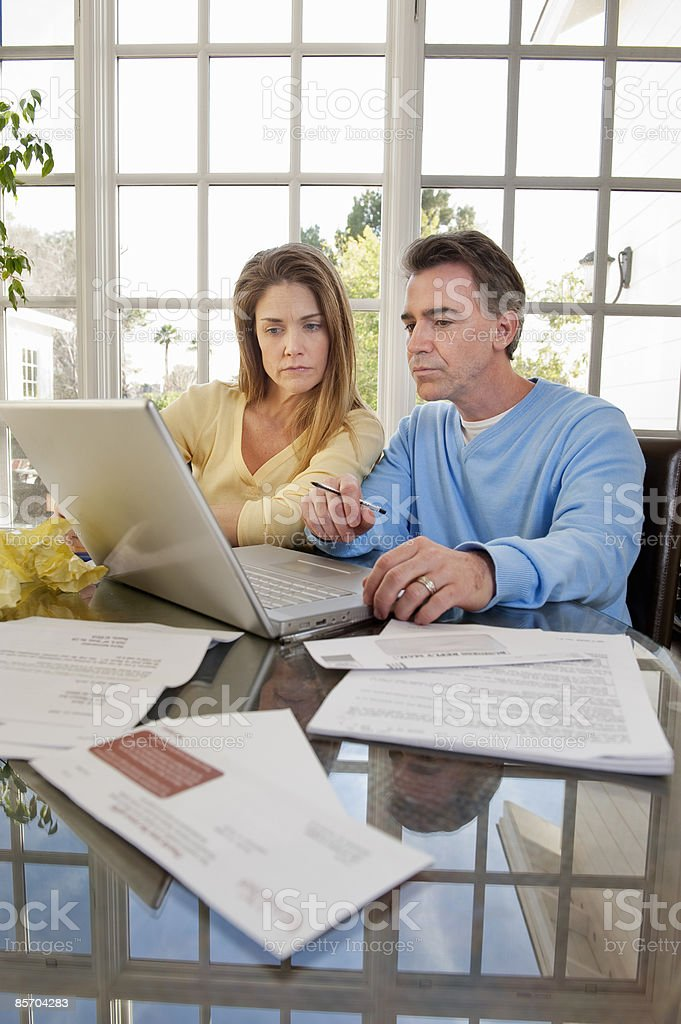 Couple at Home Budgeting royalty-free stock photo