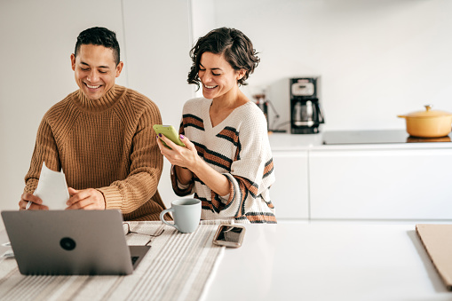 Couple at home planning family budget