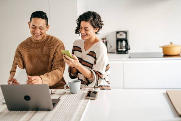 Couple at home planning family budget stock photo