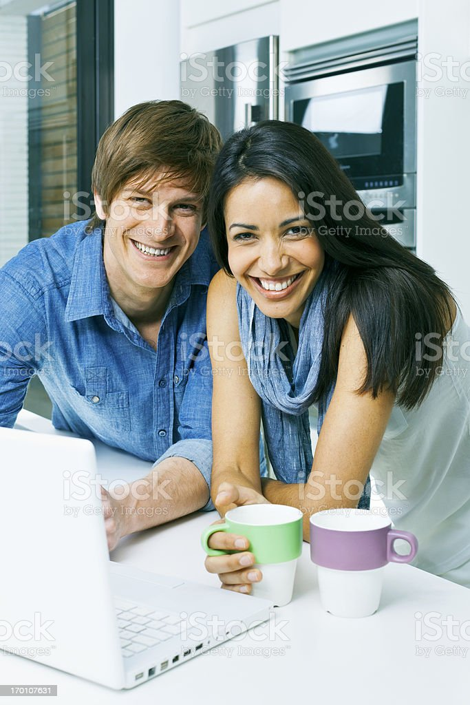Couple at home with laptop. royalty-free stock photo