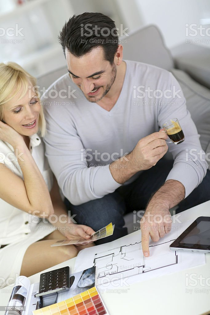 Couple at home working on project of their house royalty-free stock photo