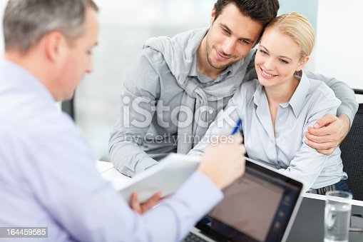 153136893 istock photo Couple at meeting with financial advisor 164459585