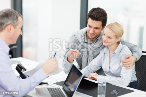 153136893 istock photo Couple at meeting with financial advisor 172476984
