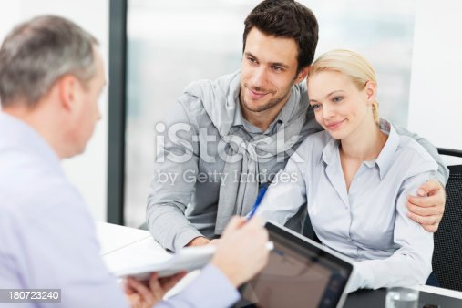 153136893 istock photo Couple at meeting with financial advisor 180723240