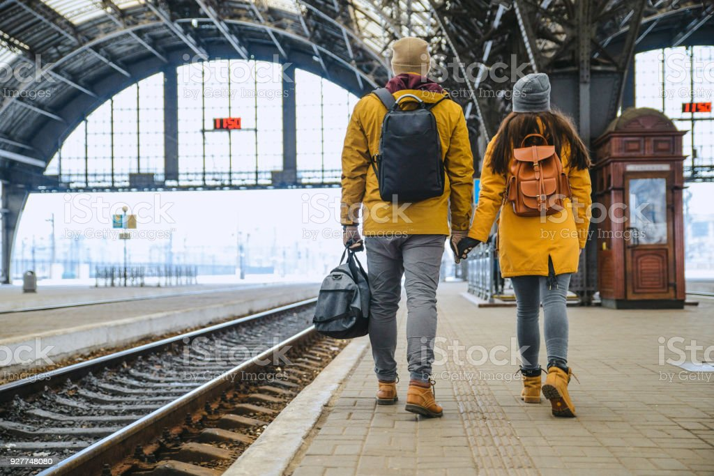 Couple At Railway Station Wiring For Train Stock Photo - Download