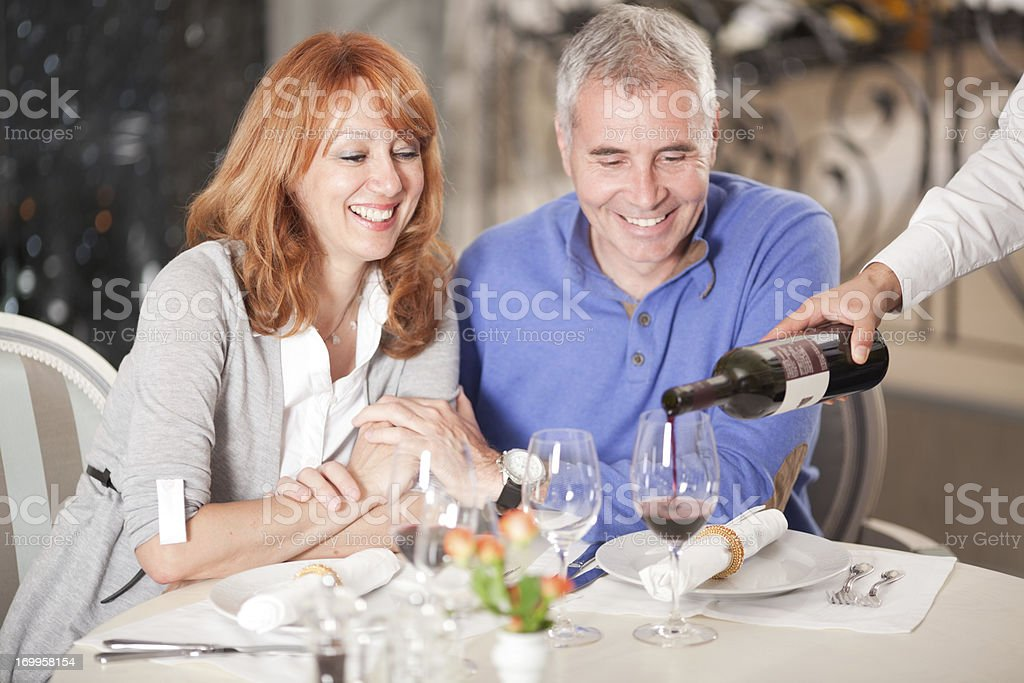 Couple at restaurant. stock photo