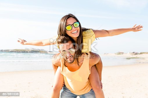 Young couple having fun at the beach