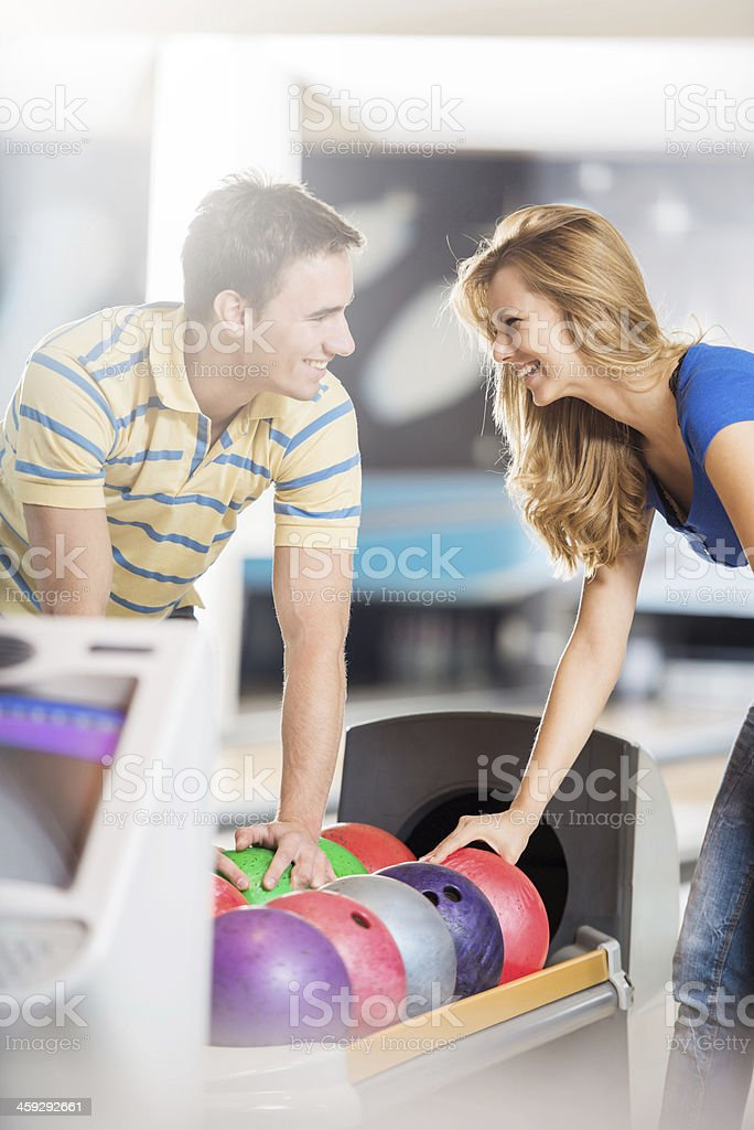Couple at the bowling alley. stock photo