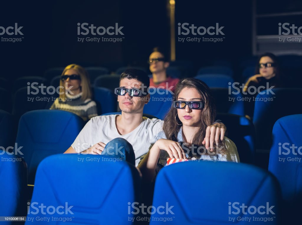 Couple At The Movies stock photo