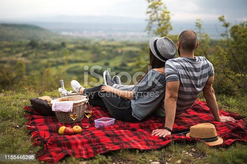 Couple at the picnic in the nature