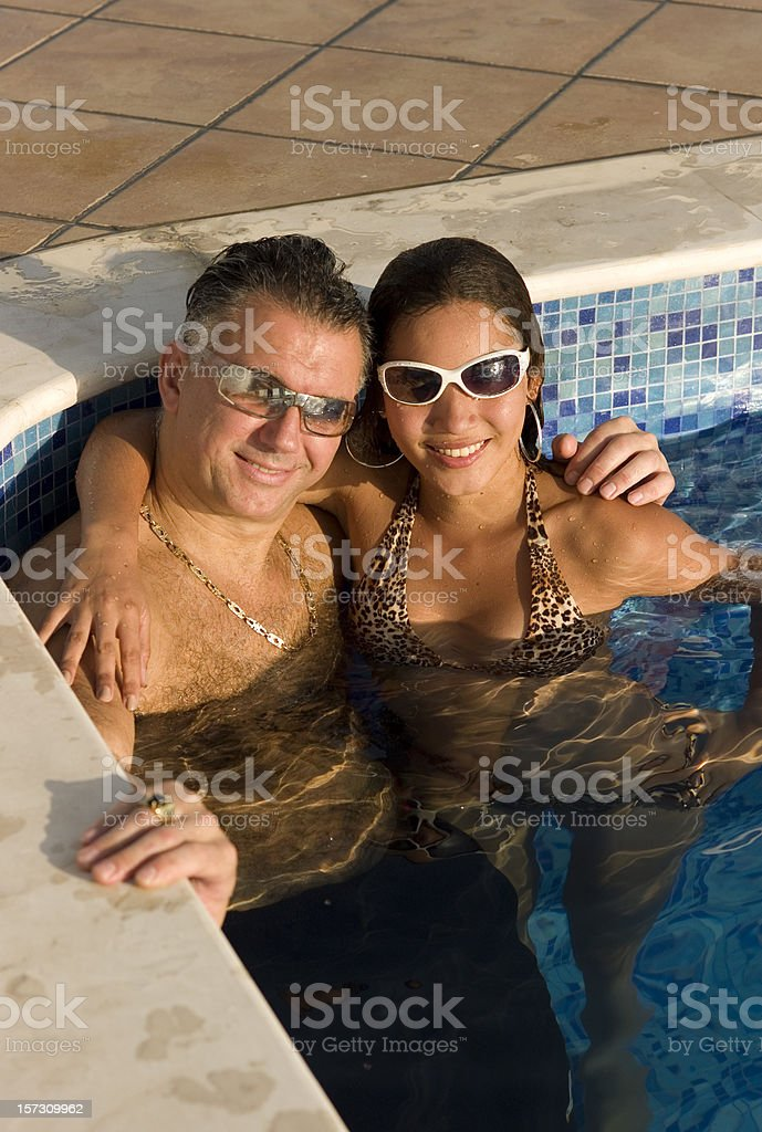 Couple at the pool stock photo