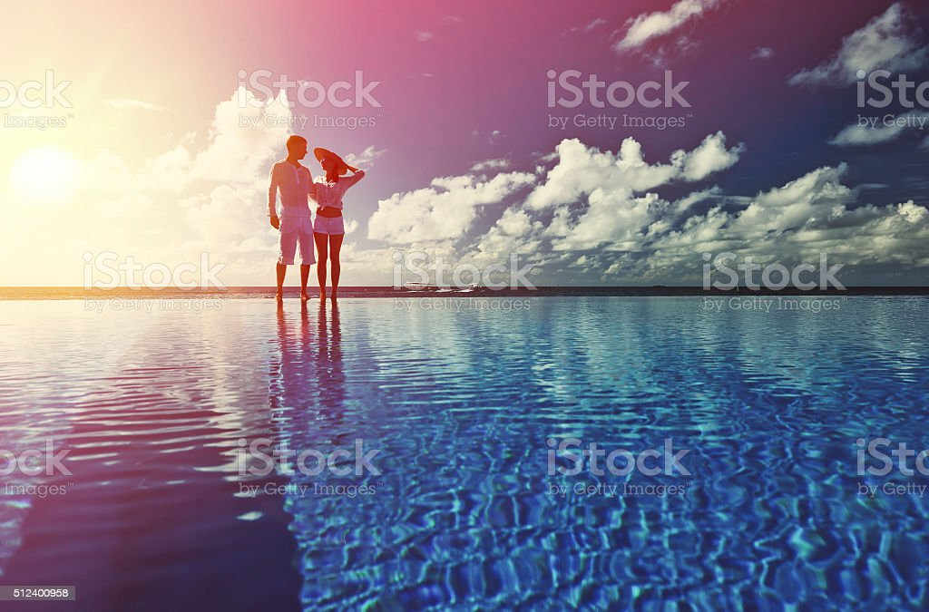 Couple at the poolside stock photo