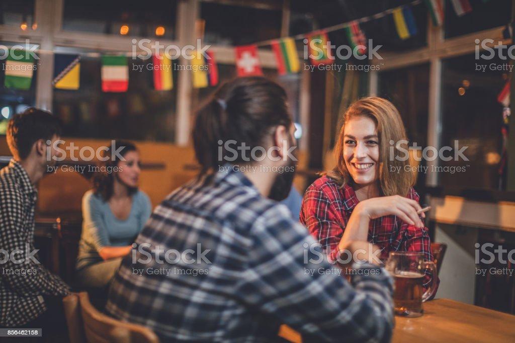 Couple at the pub talking stock photo