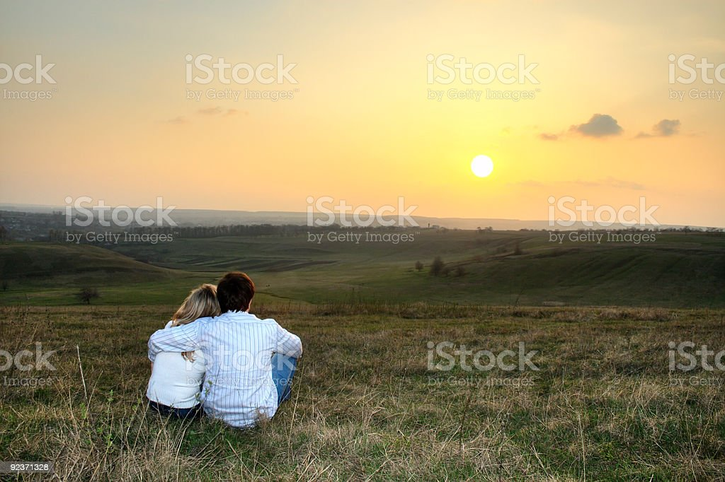 Couple at the sunset royalty-free stock photo