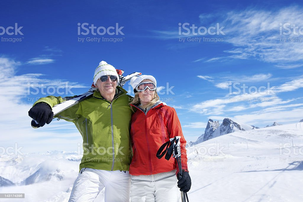 Couple at the top of a Mountain stock photo