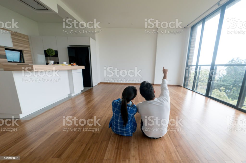 Couple at their new home stock photo