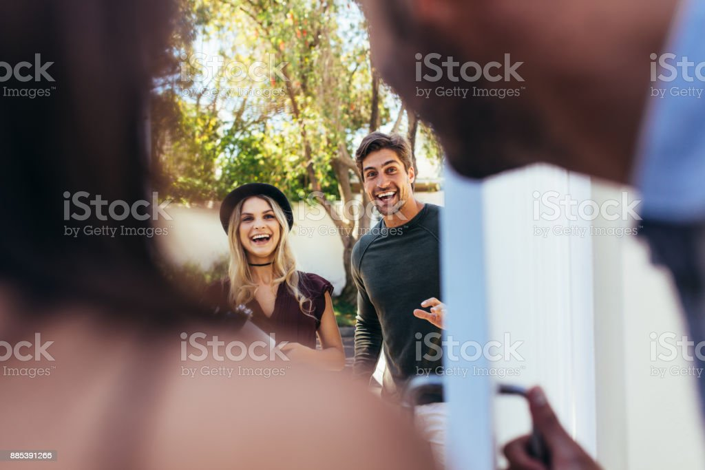 Couple attending friend's housewarming party stock photo