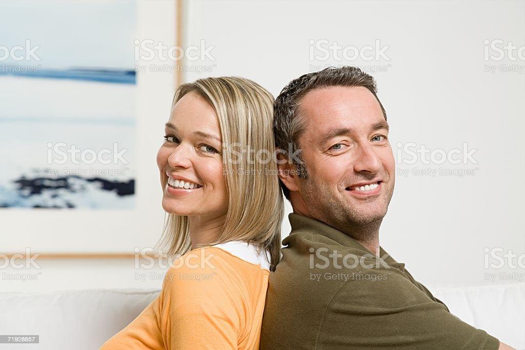 Couple back to back royalty-free stock photo